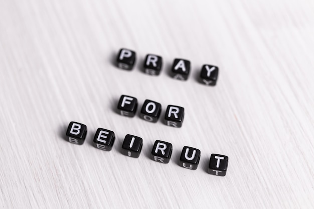 Pray for beirut sign. show of support in response to 2020 lebanon explosion. message of solidarity and support. words pray for beirut on white background.