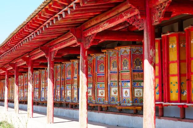 Prayer wheel in tibetan buddhist monastery arou da temple in qinghai china.
