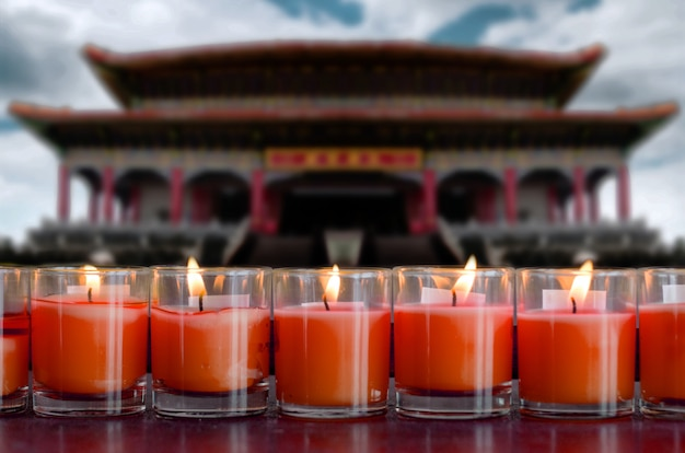 Praying and meditation with burning candle