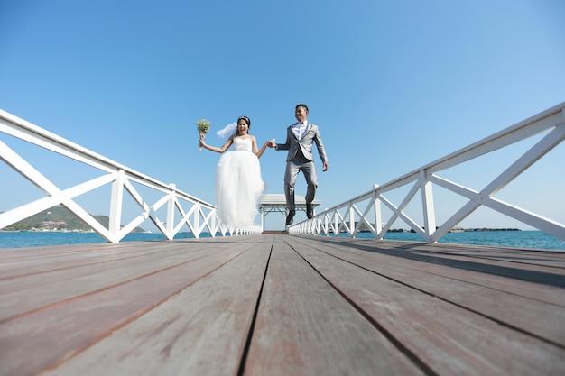 Pre wedding photography thai couples on a wooden atsadang bridge