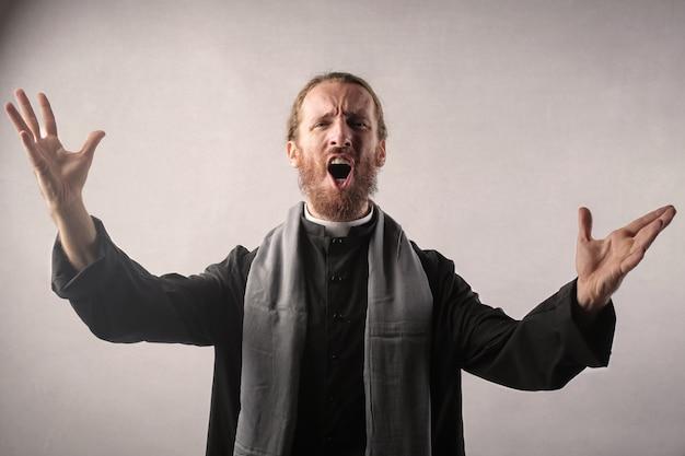 Preacher singing a word