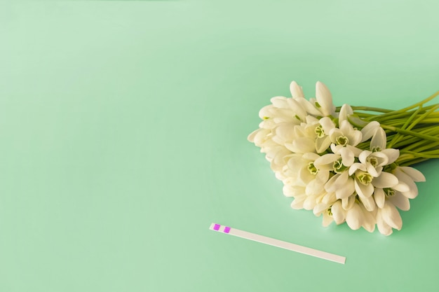 Pregnancy test and flowers