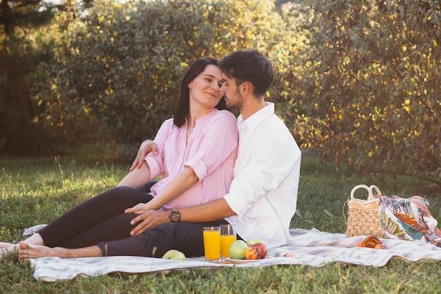 Pregnant couple on picnic