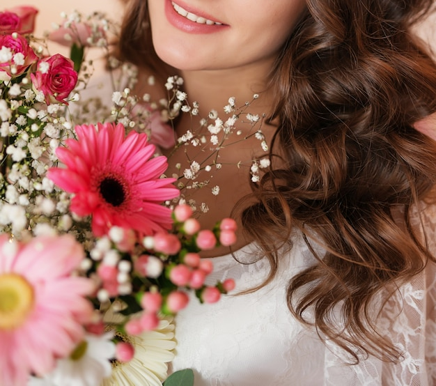 Pregnant girl on a light background with flowers