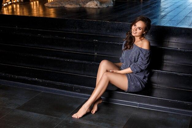 Pregnant girl sitting posing concept of healthy motherhood