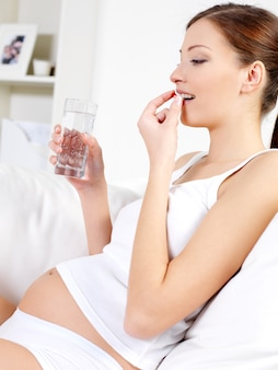 Pregnant woman accepts tablets and drinking water