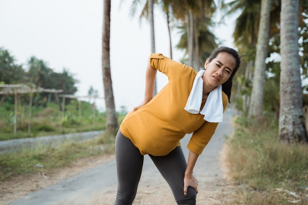 Pregnant woman back pain during exercising outdoor