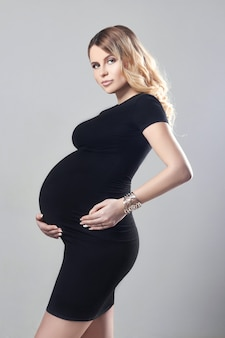 Pregnant woman black dress few days before birth