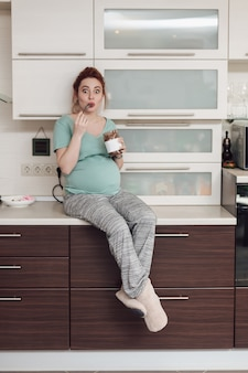 Pregnant woman enjoying eating chocolate