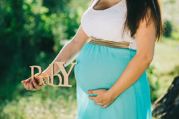 Pregnant woman feeling the baby.