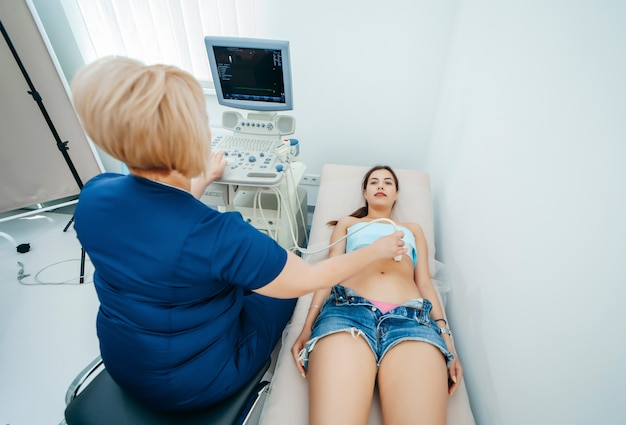 Pregnant woman getting ultrasound from doctor