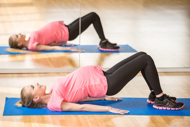 Pregnant woman at gym fitness exercise.