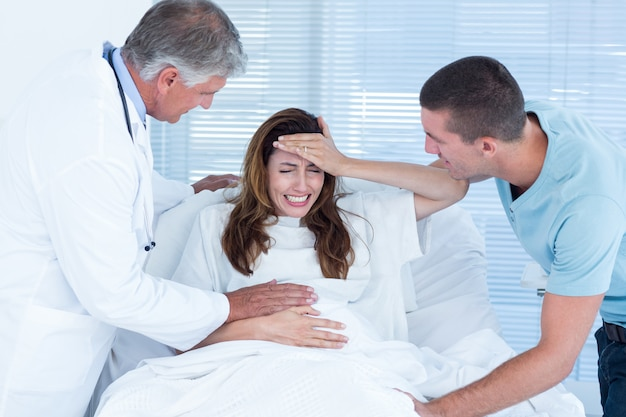 Pregnant woman having birth pangs