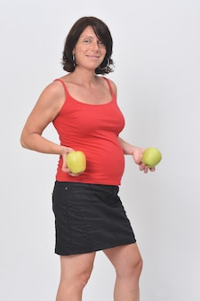 Pregnant woman holding a apple