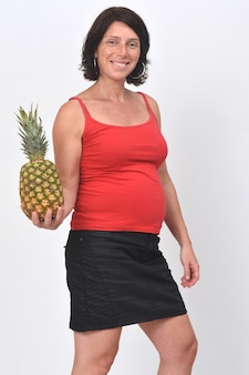 Pregnant woman holding a pineapple