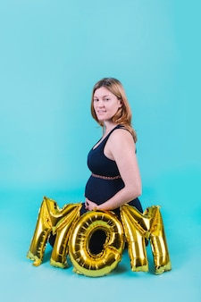 Pregnant woman and letters