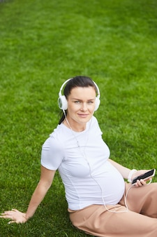 Pregnant woman listening to relax music