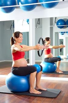 Pregnant woman pilates exercise magic ring