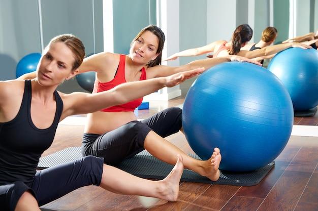Pregnant woman pilates saw exercise workout