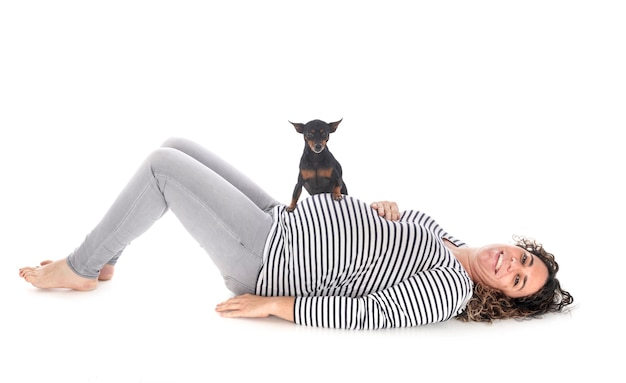 Pregnant woman and pinscher isolated