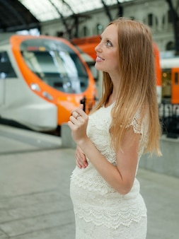 Pregnant woman at railway station