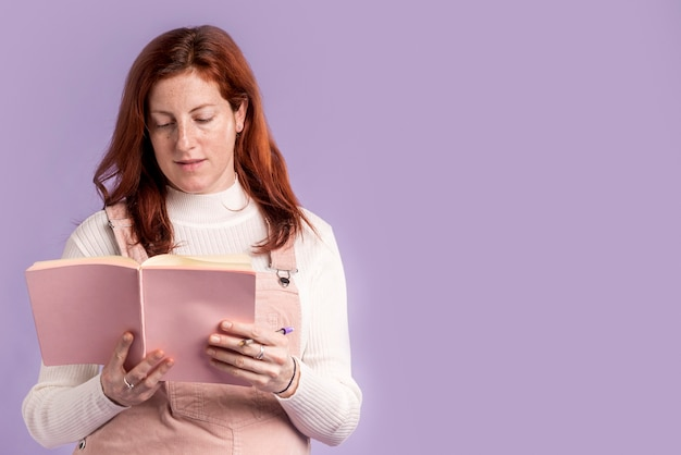 Pregnant woman reading book with copy-space