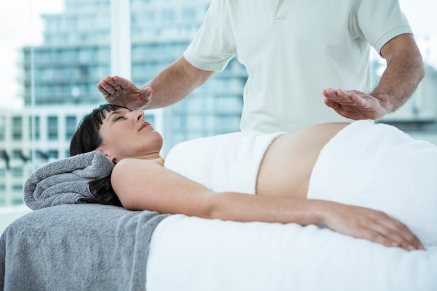 Pregnant woman receiving a massage from masseur at the health spa