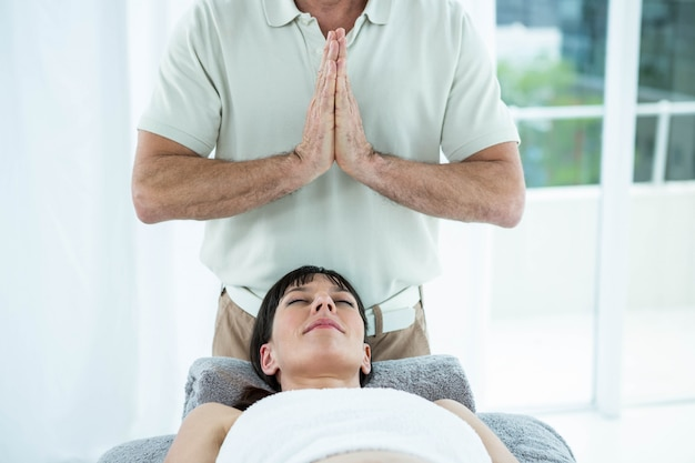 The pregnant woman laying down on bed was massage ...
