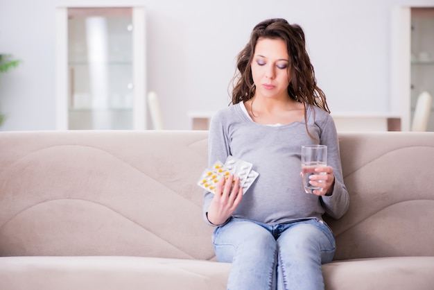 Pregnant woman sitting on sofa