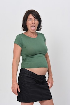 Pregnant woman sticking out tongue