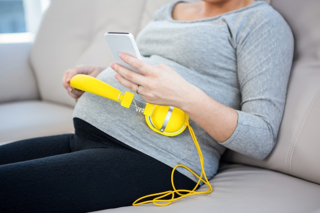 Pregnant woman using smartphone
