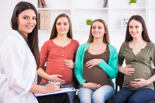 Pregnant women are listening to doctor at antenatal class.