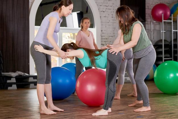 Pregnant women doing group exercises