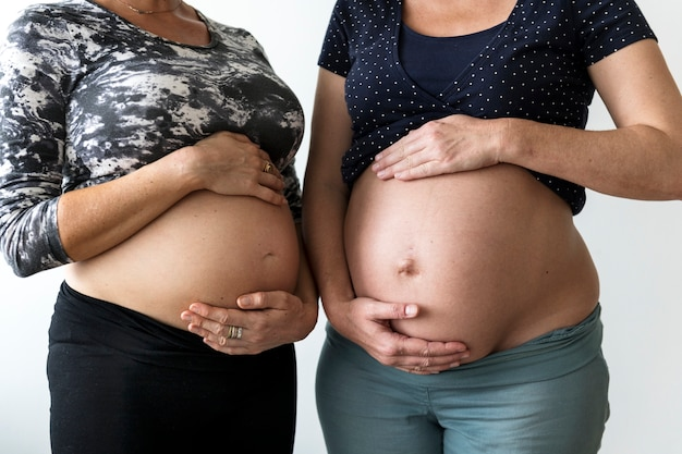 Pregnant women showing their bumps