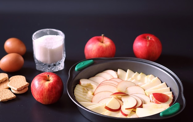 Preparation of apple pie at home. homemade pastries with apples and nuts. sweet dessert from apples baked.