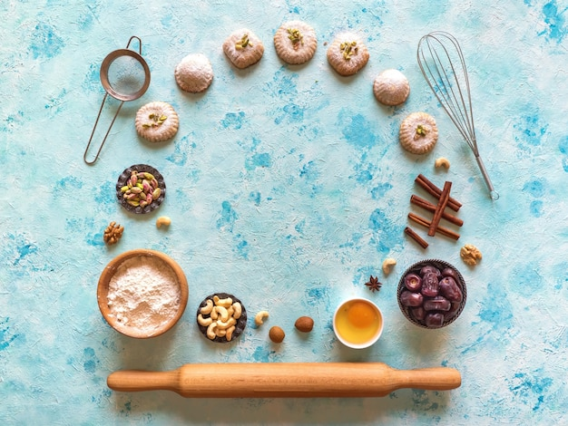 Preparation of cookies. holidays food surface. arab sweets are laid out on a blue table.