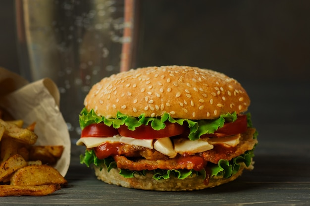 Preparation of delicious burger in a restaurant on wood table backgroun