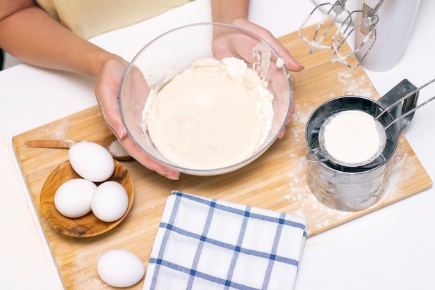 Preparation of dough for home pancakes for breakfast. ingredients on the table wheat flour, eggs