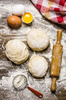 Preparation of the dough. prepared dough with the ingredients and tools for cooking.