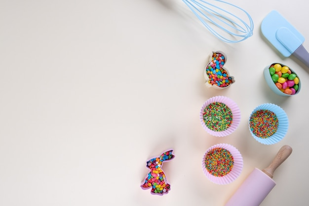 Preparation of gingerbread cookies. easter cookies cutters, tools necessary to make gingerbread pastry, colored sprinkles. easter concept.
