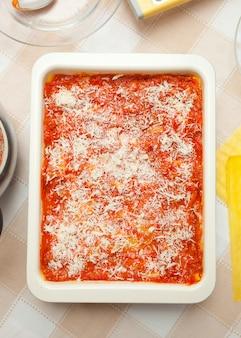 Preparation of homemade lasagna.
