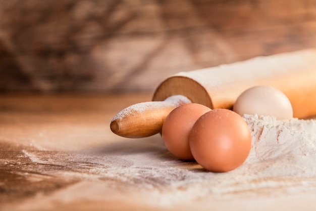 Preparation ingredients for baking on wood background