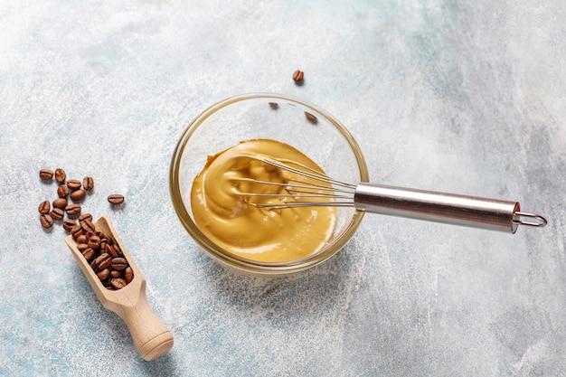 Preparation process trendy fluffy creamy dalgona coffee.