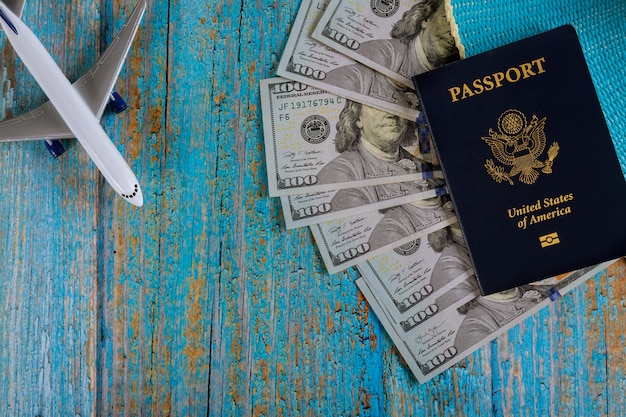 Preparation traveling of airplane on u.s. dollar bills for travel with usa passport
