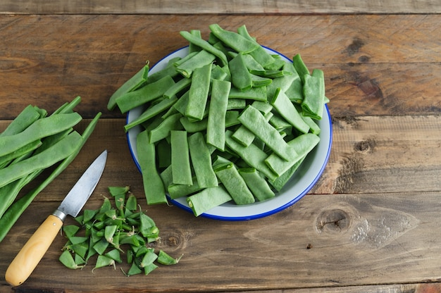 Preparation of vegetables for cooking. green beans cut on a plate. copy space.