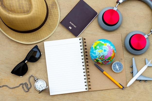 Prepare accessories and travel items on wooden board, flat lay, top view background