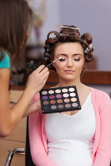 Prepare at the hairdresser and makeup artist before party
