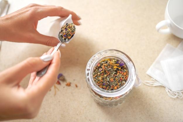 Prepare to make a fresh herbal tea. close up.