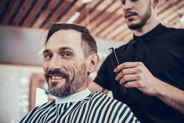 Prepare man for shaving in barbershop