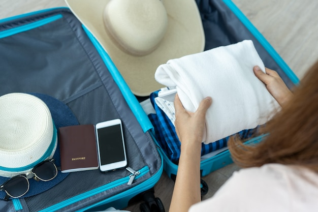 Prepare your luggage for travel concept. clothing and accessories to prepare for vacation.